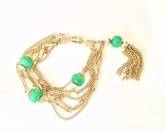 Multiple chain bracelet with tassel and green beads gold tone retro jewelry