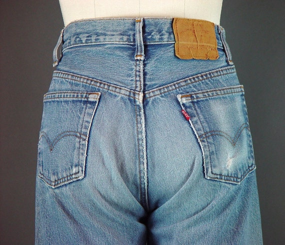 Distressed Jeans With Silver Ring Detail