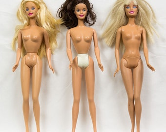 Three Barbie Dolls Two with Blonde Hair blue eyes, One Brown Hair Blue eyes, open Mouths
