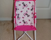 Doll stroller with seat made from Minnie Mouse fabric