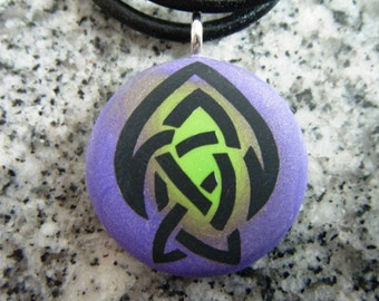 Celtic Brotherhood of the Arrow Symbol hand carved on a polymer clay purple/green color background.  Pendant comes with a FREE 3mm necklace.