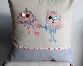 Embroidered cushion featuring children's drawing