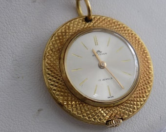 Vintage Bucherer 17 jewel Swiss pendant watch with antique watch chain, working condition collectible watch