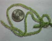 Full strand of faceted peridot beads
