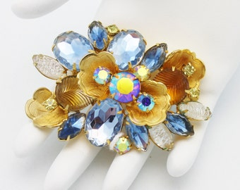 Blue and Gold Brooch by DeLizza and Elster