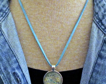 Hand painted abstract globe - textured gold, silver and blue metallic colors -  faux suede blue cord or silver chain