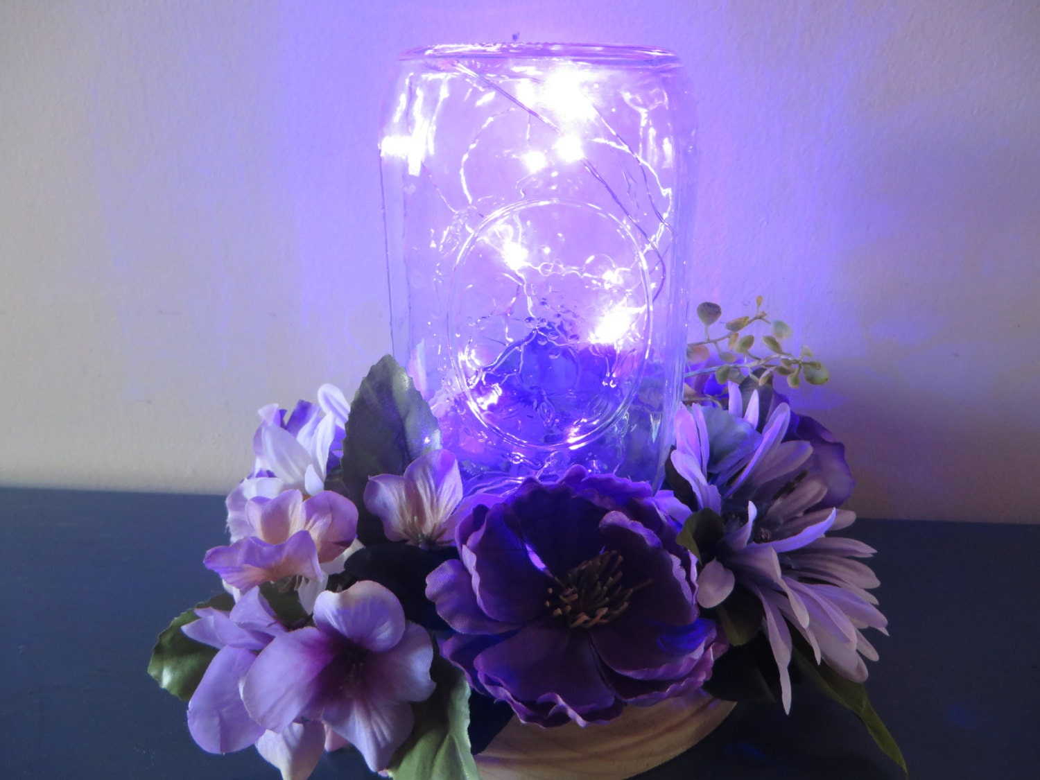 Purple flower centerpiece mason jar with led lights and