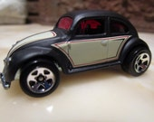 "Vintage 1988' Hotwheels Volkwagen"" satin black with 5 spoke chrome wheels."