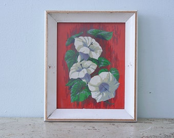 Vintage Vibrant White Wooden Frame with White Petunias on Red Background