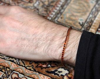 tangerine black bracelet for men - black and orange very small bead bracelet from Maria-Helena Design