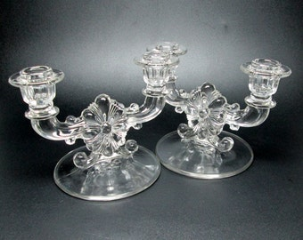 elegant glass double candle holder pair with a flower center mystery maker