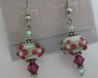 Fuchsia and green floral lampwork glass earrings with Swarovski crystal accents