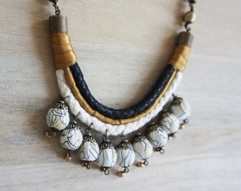 Handmade Fabric Spheres And Rope Necklace in Black, Gold and Beige