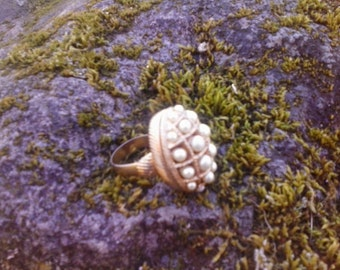 70s large goldtone and faux pearl poison ring by Avon
