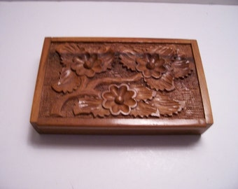 Beautiful carved wood box with flowers and leaves