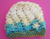 Crochet newborn beanie with starfish