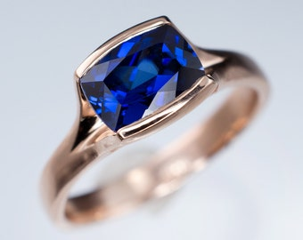 Cushion Blue Lab Sapphire Fold Solitaire Engagement Ring in Rose Gold, Sterling Silver, Palladium, White Gold, Yellow Gold