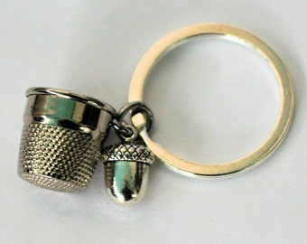 Thimble and Acorn Hidden Kisses Key Ring Silver Metal Peter Pan and Wendy