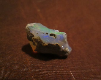 "ethiopian opal rough flash, blue, green  5/8"" x 1/2"" approx 10 carats of life"