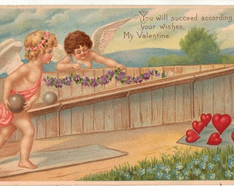 Vintage Valentine Postcard, Cupids Bowling to Knock over Hearts set up like Bowling Pins