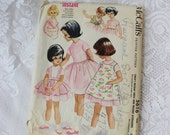 1960 Vintage Sewing Pattern- Girls size 4 Dress, Pinafore apron, Smock, Jacket, Collar, and Cummerbund- McCall's