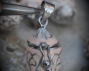 Tear Drop Pretzel Design Prayer Box Locket in Silver Plated Three Dimensional Pendant Charm Cream Color