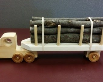 Hand made unfinished wooden log truck
