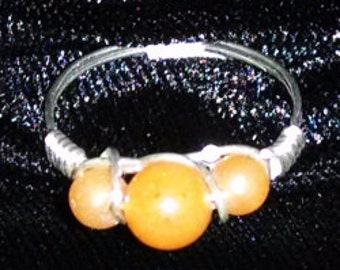 Peach Aventurine 6mm and 4mm beads wire wrapped in 22 gauge sterling silver wire.