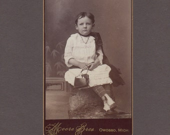 CDV of a Beautifully Dressed Little Girl with Her Purse