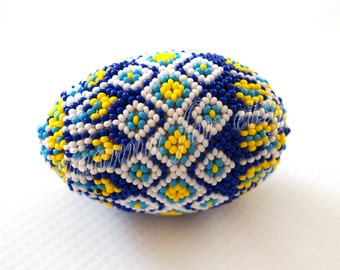 Beaded eggs in colors of Ukraine. Blue, yellow, blue and white.