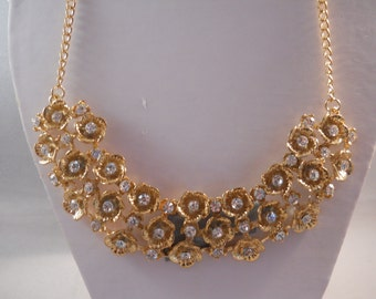 Bib Necklace with Gold Tone and Clear Rhinestone Flower Pendants on a Gold Tone Chain
