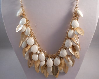 3 Row bib Necklace with Gold Tone Leeves and White Teardrop Beads on a Gold Tone Chain