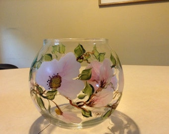 Beautiful cherry blossom flower and green leaves painted on a bowl style candle holder.