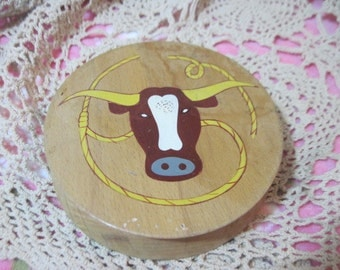 Wooden Hamburger Press with Steer and ropes  on Front of It