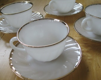 Fire King Gold Anniversary Swirl Teacup Saucer Sets Very good  4 sets included.