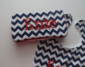 A navy and white chevron decorated  travel wipes case , monogram included with bib and  other items available .
