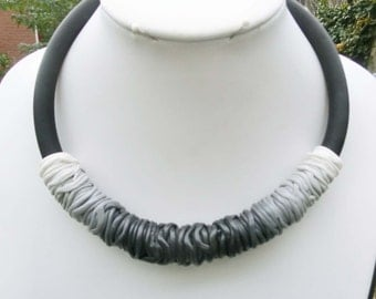"""Black grey white ombre necklace/ bow shape/ gradient shaded thin polymere tubes on 4"""" rubber cord with lobster clasp and chain."""