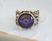 Evil eye glass disc ring - swarovski irrediscent blue, purple vintage glass cab set in a decorative, fully adjustable ring.