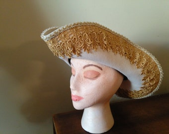 Cream bicorn hat with gold lace trim