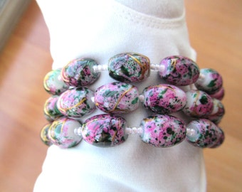 Colorful pink coil bracelet butterflies at ends one size fits all