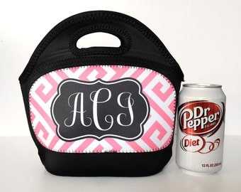 Small neoprene school lunch tote shown in pink greek key print and  curled monogram