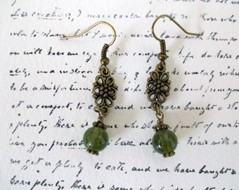 Adorable green bead dangle earrings in antiqued bronze.  French hook earring wires.