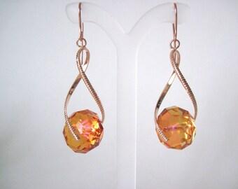 crystal earrings on rose gold
