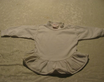 Vintage White 12 month baby snap on top.  Fir knit label