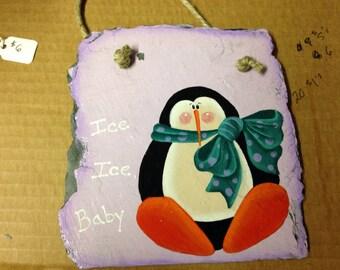 Cute wintery penguin painted on slate.