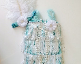 Aqua lace romper with sparkle fringe and a matching aqua sequin and feather headband. Flapper Girl.  Great Gatsby party. Roaring 20s party.