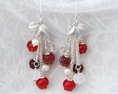 Glass lampwork earrings with cranberries and ice. Red and silver color.