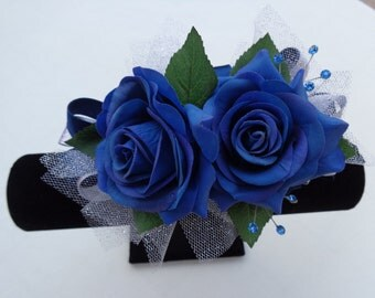 Corsage and boutonniere in blue real touch roses
