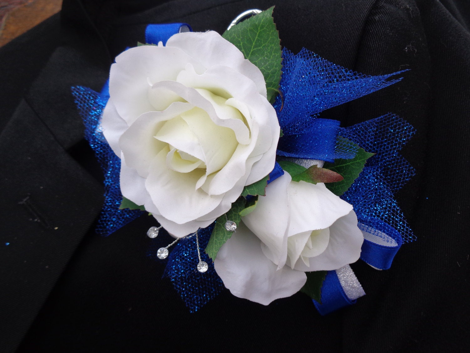 Corsage And Matching Boutonniere In White By