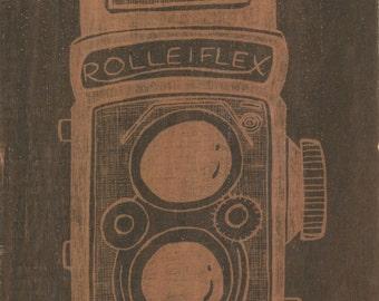 Rolleiflex. B/W print on wood.